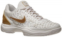 Damskie buty tenisowe Nike WMNS Air Zoom Cage 3 - phantom/metallic gold